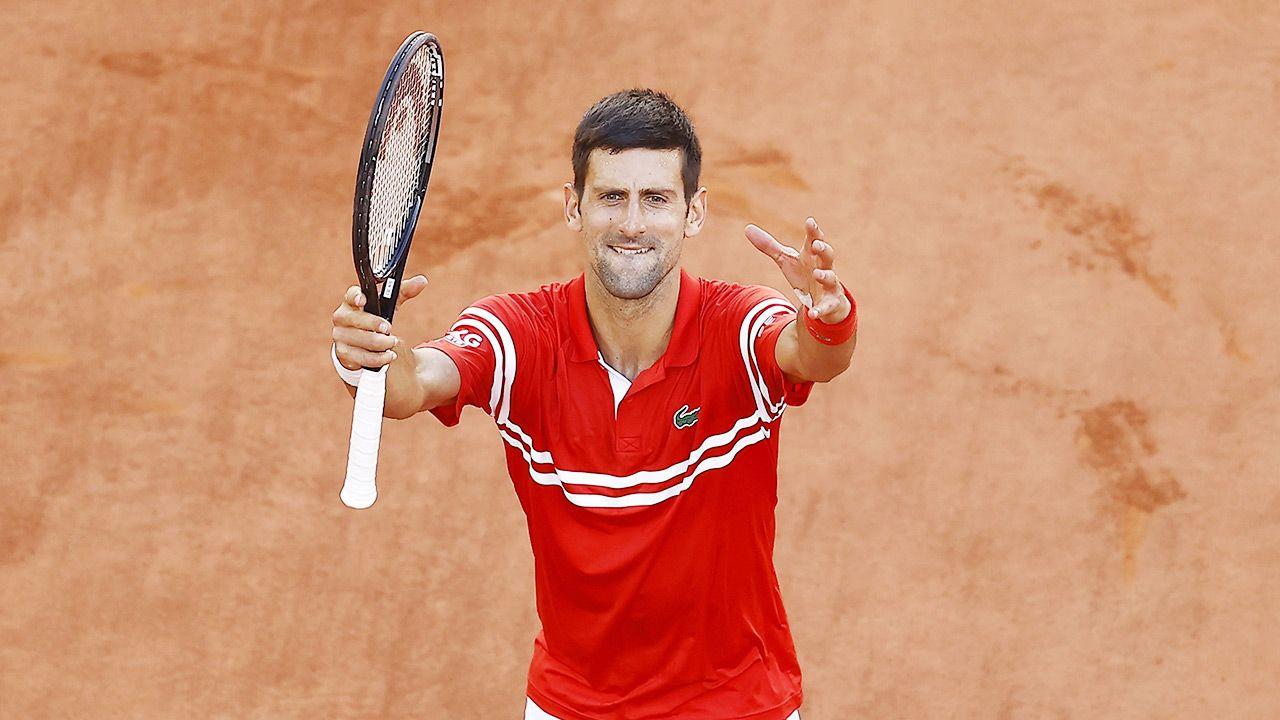 Novak Djoković wygrał wielkoszlemowy turniej po raz 19. w karierze (fot. PAP/EPA/IAN LANGSDON)