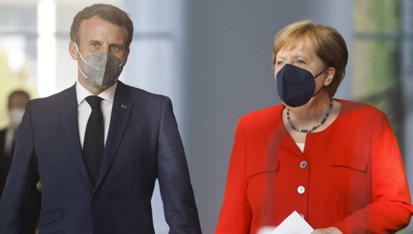 Prezydent Emanuel Macron (L) i kanclerz Angela Merkel (P) spotkali się w Berlinie (fot. PAP/EPA/AXEL SCHMIDT / POOL)