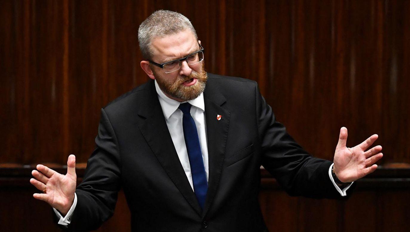 Poseł Konfederacji Grzegorz Braun (fot. PAP/Radek Pietruszka)